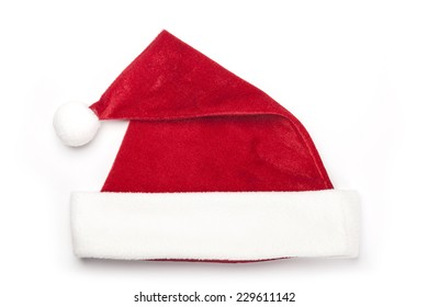 A christmas red hat for gift isolated white, top view at the studio.