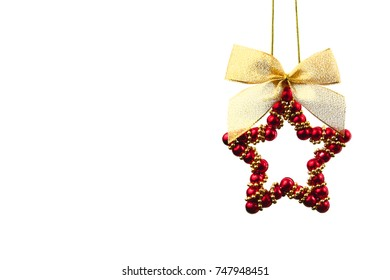 Christmas red shiny star with golden lace isolated over white background. Studio photo.