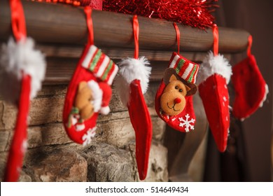 Christmas red stocking hanging from a mantel or fireplace, decorated for