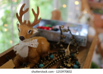 Christmas reindeer doll decorated with a cute bow tie.
