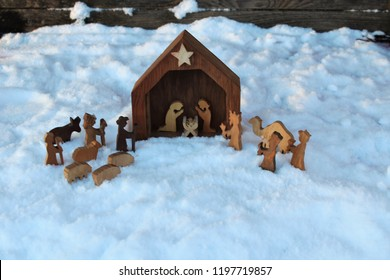 christmas religious manger or nativity made of wood and set in the snow