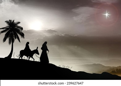Christmas religious nativity concept: Mary and Joseph with a donkey