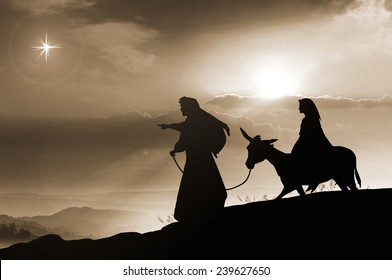 Christmas religious nativity concept: Silhouette pregnant Mary and Joseph with a donkey on Bethlehem background
