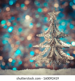 Christmas retro tree toy over defocused background