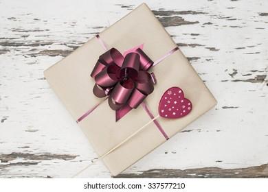 Christmas ribbon gift and a heart