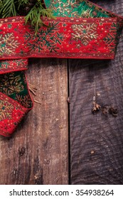 Christmas ribbon on a wooden background
