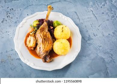 Christmas roast duck served on a grey beton table