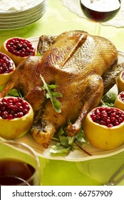 Christmas roast goose with apples stuffed with cranberries