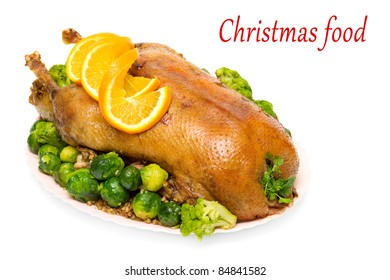 Christmas roast goose with Brussels sprouts and broccoli isolated on white