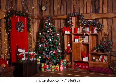 Christmas Room Interior Design, Xmas Tree Decorated By Lights, Presents, Gifts, Toys, Candles And Garland Lighting