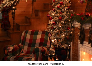 The Christmas room of Santa Claus with a cozy sofa and a fir-tree