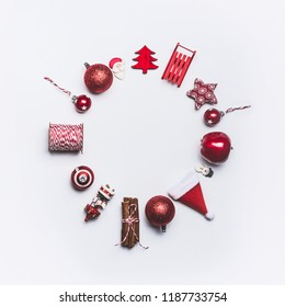 Christmas round circle frame composition on white background, top view. Red Christmas decoration and gift wrapping and package objects flat lay. Copy space for your design