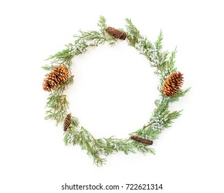 Christmas round frame made of winter evergreen plants and natural cones. Flat lay. Top view