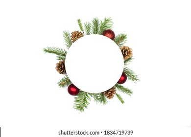 Christmas round frame mockup made of spruce branches, red decorations, fir cones flat lay isolated on white background, copy space. Christmas composition with wreath top view. Xmas celebration - Shutterstock ID 1834719739
