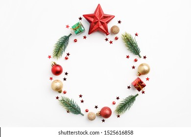 Christmas Round Frame from Natural Branches, Christmas Balls and Decorations isolated on white background. Flat Lay