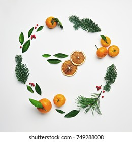 Christmas Round Frame from Natural Branches and Tangerines. Flat Lay