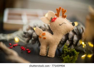 Christmas rustic decor. Felt Bambi, cone ,moss and lights