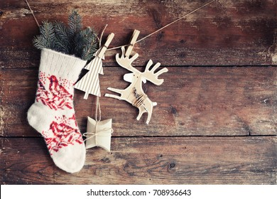 Christmas rustic decorations over dark wooden background