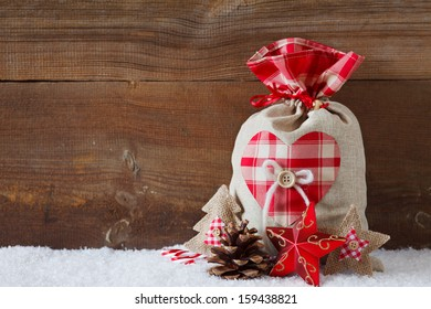 christmas sack before wooden board
