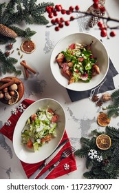 Christmas Salad Set with Quail, Salmon, Fruits and Vegetables Top View. Beautiful New Year Table with Winter Decorations, Flat Lay Delicacy Salats, Festive Cutlery and Napkins Close Up