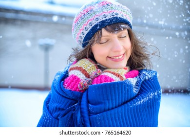 Christmas sale. Beautiful surprised woman in red mitts and white sweater winter background with snow, emotions. Funny laughter woman portrait. New year sales