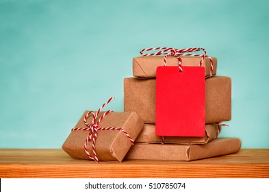 Christmas sale concept, stack of christmas presents with red tag with empty space for a text, front view