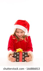 Christmas Santa blond kid girl happy excited with ribbon gift isolated on white background