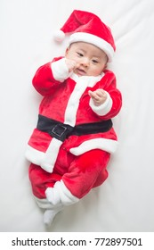 Christmas Santa Claus asian baby boy and happy new year festival
