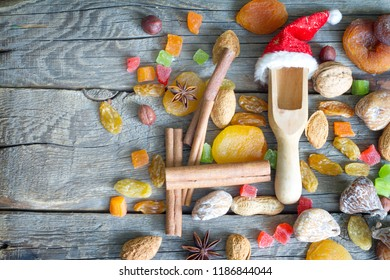 Christmas Santa Claus hat with dried fruits and nuts on wooden background
