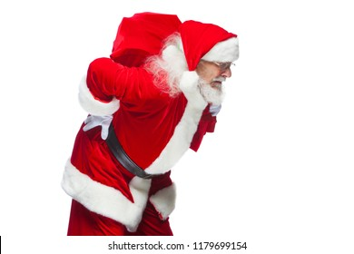 b77b40239d Santa Claus is suffering from back pain and holds a red bag with gifts