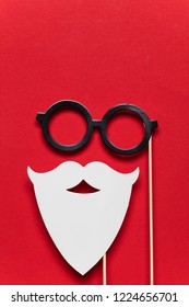 Christmas Santa Claus white beard and glasses on a red background