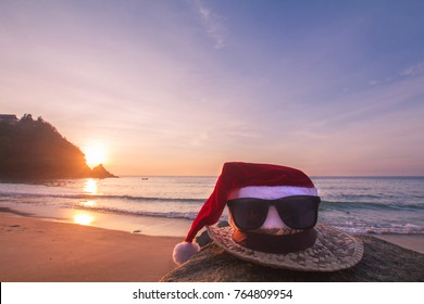 Christmas Santa hat Bespectacled on the beach. are texture Nature background creative tropical layout made at phuket Thailand