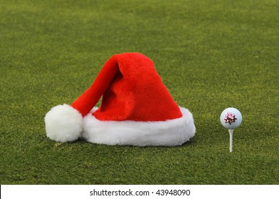 Christmas Santa Hat and Golf Ball with a Bow on a Tee