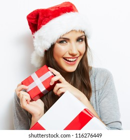 ef18df5404b33 Christmas Santa hat isolated woman portrait hold christmas gift. Smiling happy  girl on white background