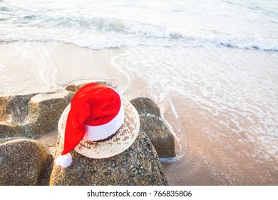 Christmas Santa hat on the beach. are texture Nature background creative tropical layout made at phuket Thailand