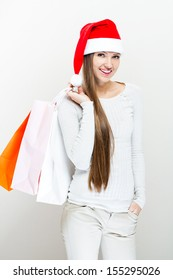 Christmas Santa hat  woman with shopping bags. Smiling happy girl .