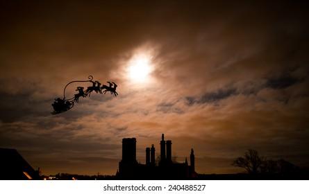 Christmas, Santa's Sleigh over dark Gothic chimneys