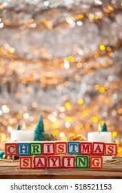 Christmas Saying Written With Toy Blocks On Holiday Card Vertical Background With Copy Space.