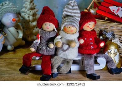 Christmas scence. Two funny snowmen and children (toys) on sleds.Christmas background