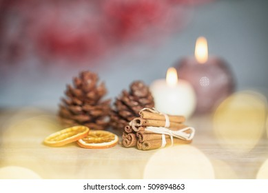 Christmas scene with cinnamon and oranges