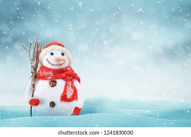 Christmas scene with a cute snowman. Free space for text on right side. snob, light and bokeh in background.