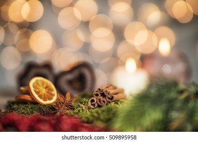 Christmas scene with gingerbread, cinnamon and oranges