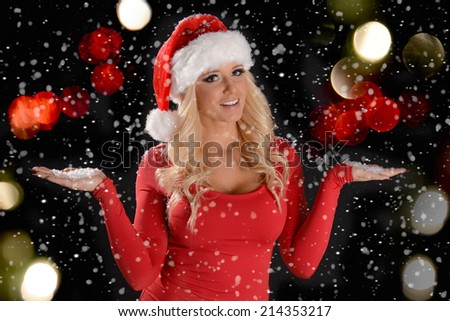 a5b2bcf2bc354 Christmas Scene of a pretty young woman wearing Santa hat in the snow