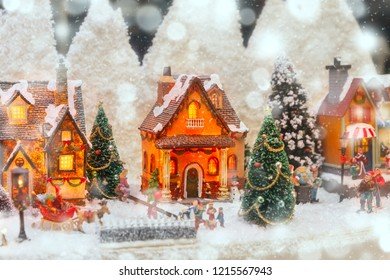Christmas scene with tiny houses and Christmas tree at a Christmas souvenir market shop in Strasbourg, Alsace, France