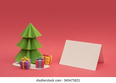Christmas season paper cut design: 3d handmade xmas pine tree, gift boxes and empty greeting card template with clipping path. Ideal for holiday project.