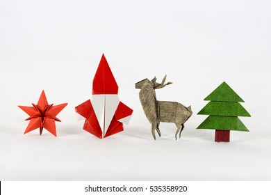 Christmas set. Santa claus, red star, deer and Christmas tree origami, paper craft