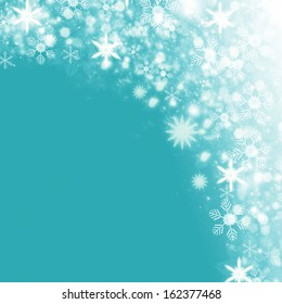 Christmas shiny snow background with lights and copy space in blue silver colors