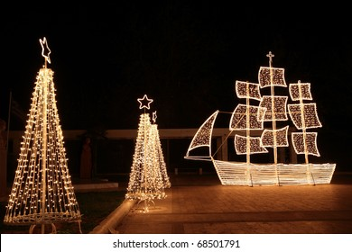 Christmas ship at night. In the Greek tradition ( especially in the islands ) it is common to ornament a ship  instead of a tree for Christmas