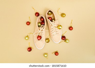 Christmas shoe shop background with beige sneakers and red and gold decorations