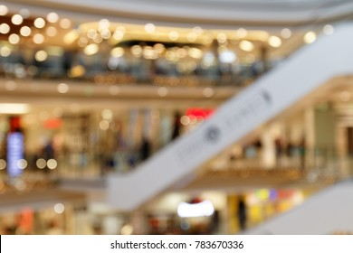 Christmas Shopping: Christmas atmosphere in multi-level Shopping Centre blurred background